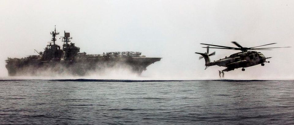 U.S. Marines jump from a CH-53E Super Stallion helicopter into the Gulf of Aden