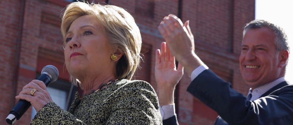 New York City Mayor applauds as Democratic U.S. presidential candidate Hillary Clinton addresses supporters Brooklyn New York