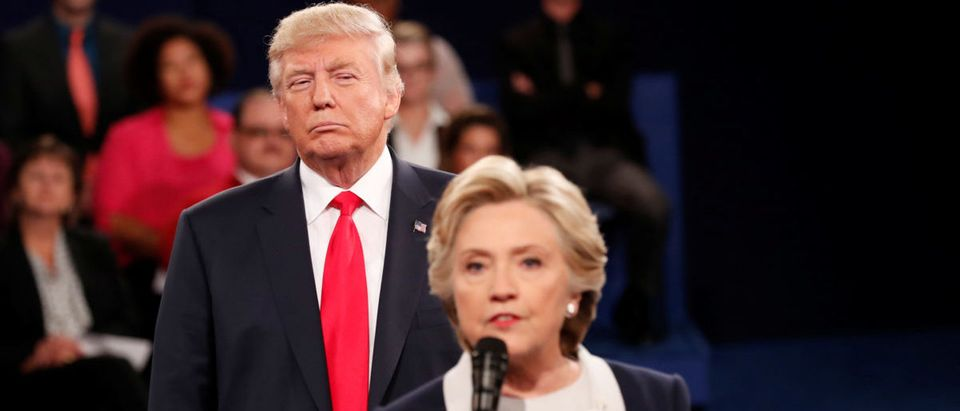 Republican U.S. presidential nominee Donald Trump listens as Democratic nominee Hillary Clinton answers a question from the audience during their presidential town hall debate at Washington University in St. Louis, Missouri, U.S., October 9, 2016. (Photo: REUTERS/Rick Wilking)