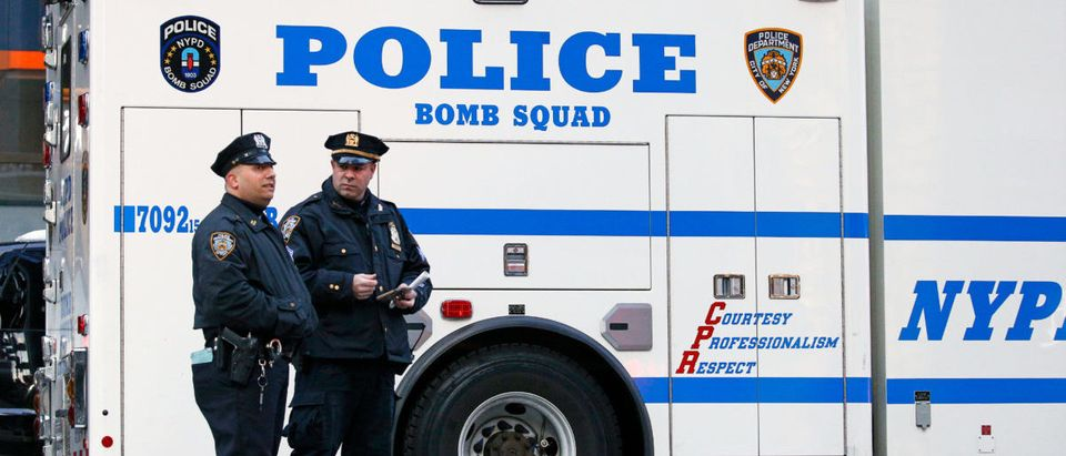 Police officers stand outside the New York Port Authority in New York City after reports of an explosion