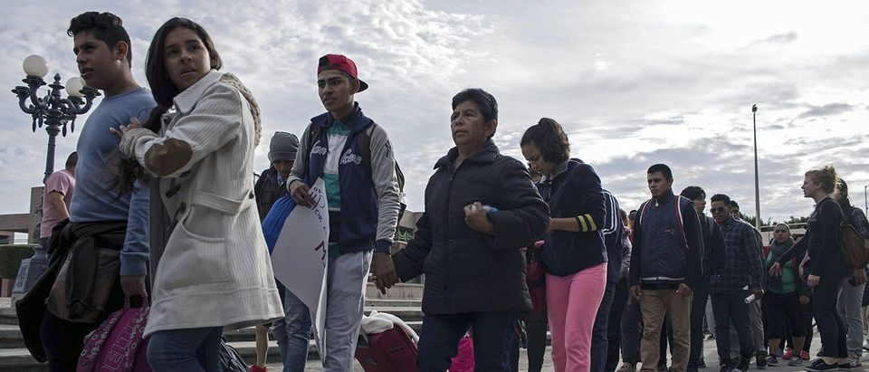 Central American migrants seeking asylum in the United States, walk to the US-Mexico border at El Chaparral port of entry on November 12, 2017, in Tijuana, northwestern Mexico. (Photo: GUILLERMO ARIAS/AFP/Getty Images)