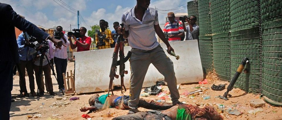 Weapons arae gathered from two dead militants suspected of being members of the al-Shabab, in Mogadishu on April 16, 2017. Somali security forces shot dead two suspected al-shabab militants, an Al-Qaeda linked extremist group, who were said to be involved in firing rockets. Mohamed Abdiwahab/AFP/Getty Images.