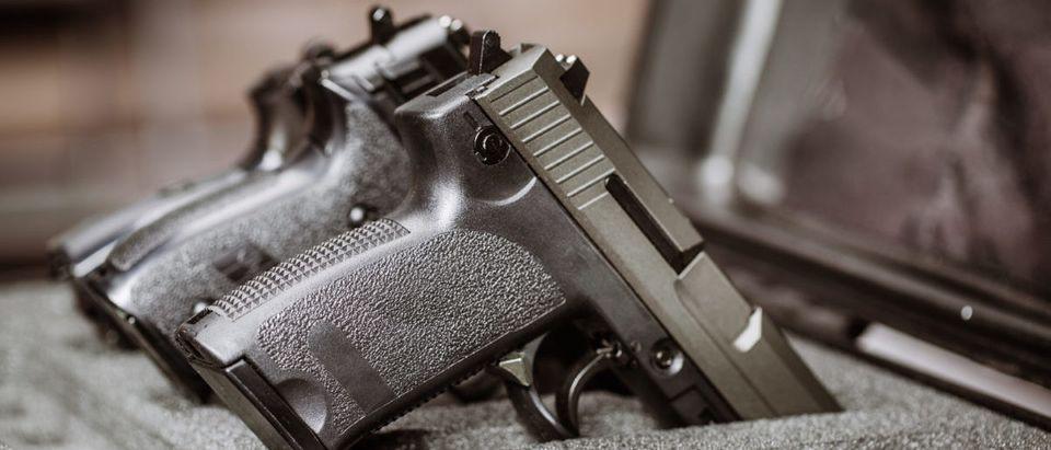 Black handgun in plastic Secure Storage Case