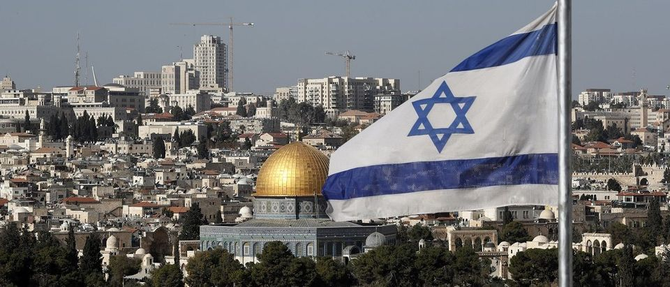 The Israeli flag flutters in front of the Dome of the Rock mosque and the city of Jerusalem, on December 1, 2017. US President Donald Trump may recognize Jerusalem as the capital of Israel. The international community says Jerusalem's status must be negotiated between Israelis and Palestinians. Israel occupied east Jerusalem in the 1967 Six-Day War and later annexed it in a move never recognised by the international community. (THOMAS COEX/AFP/Getty Images)
