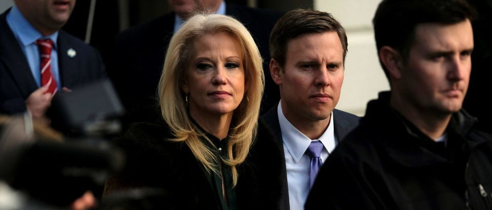 White House counselor Kellyanne Conway looks on as U.S. President Donald Trump speaks to reporters before departing the White House for New York in Washington, U.S., December 2, 2017. REUTERS/James Lawler Duggan