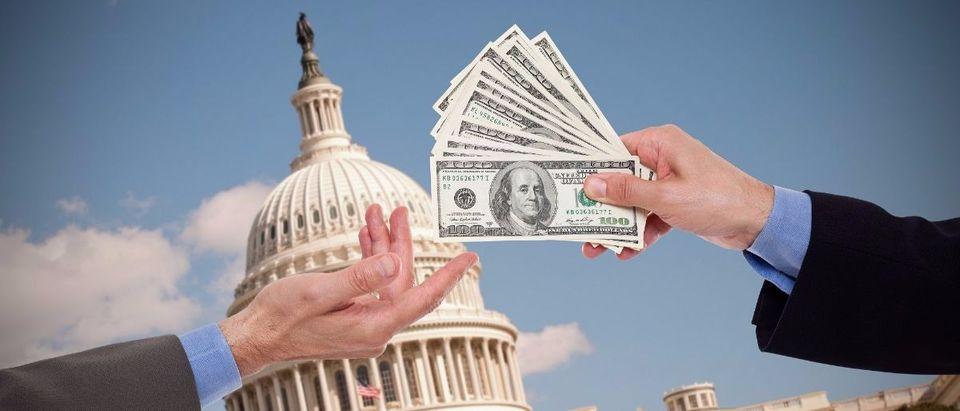 money politics Shutterstock/Carlos Yudica