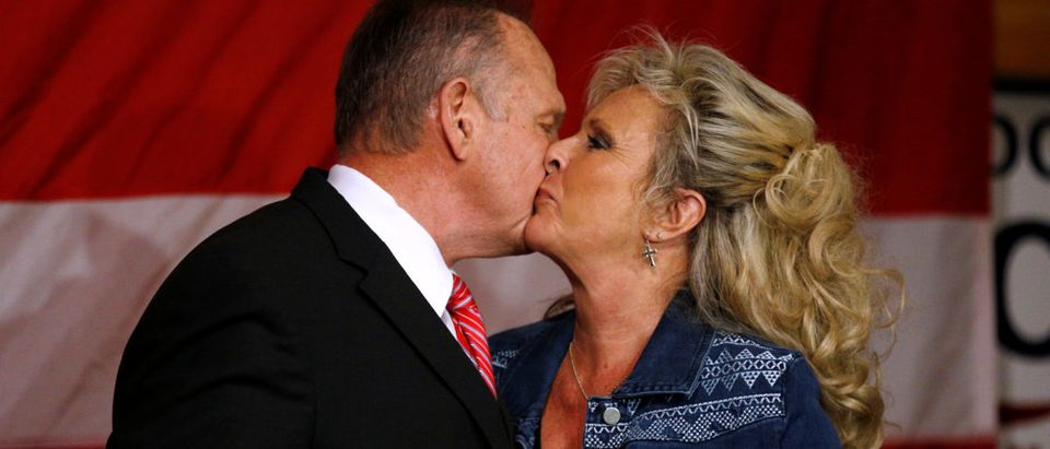 Republican candidate for U.S. Senate Judge Roy Moore kisses his wife Kayla Moore during a campaign rally in Fairhope, Alabama, U.S., December 5, 2017. REUTERS/Jonathan Bachman