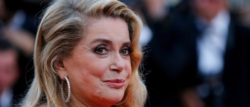 FILE PHOTO: 70th Cannes Film Festival - Event for the 70th Anniversary of the festival - Red Carpet Arrivals - Cannes, France. 23/05/2017. Actress Catherine Deneuve poses. REUTERS/Stephane