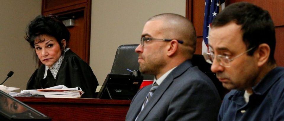 Judge Rosemarie Aquilina looks at Larry Nassar in Lansing, Michigan
