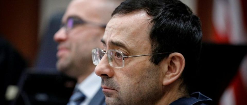 Larry Nassar listens to a victim during his sentencing hearing in Lansing, Michigan