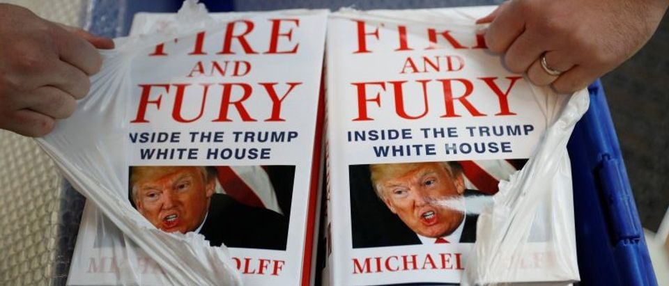 A shop worker opens a package containing copies of Michael Wolff's book 'Fire And Fury' as they go on sale inside a branch of the Waterstones book store in Liverpool, Britain.