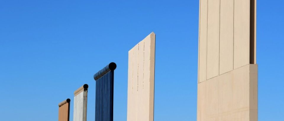 FILE PHOTO: The top of five of U.S. President Donald Trump's eight border wall prototypes are shown near completion along U.S.- Mexico border near San Diego