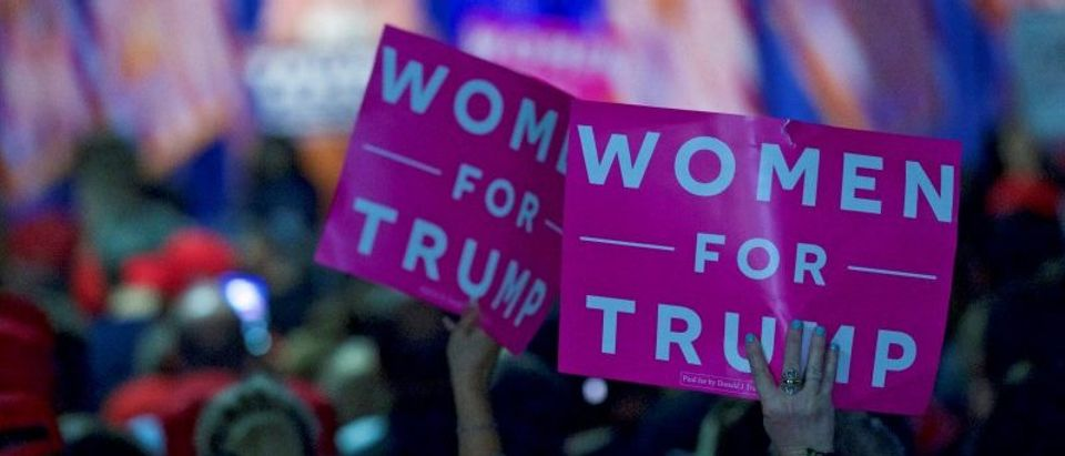 """FILE PHOTO: Supporters wave """"Women For Trump"""" posters while Melania Trump holds an event in Berwyn"""