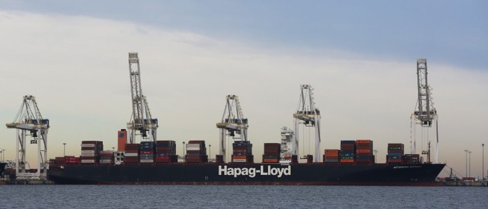 Shipping containers are unloaded at Roberts Bank Superport in Delta,