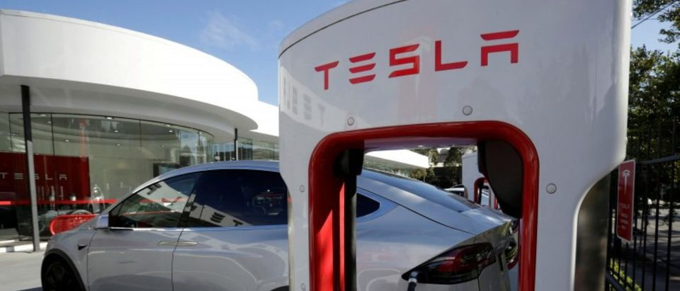 FILE PHOTO: A Tesla Model X vehicle is charged by a supercharger outside a Tesla electric car dealership in Sydney, Australia, May 31, 2017. REUTERS/Jason Reed/File Photo