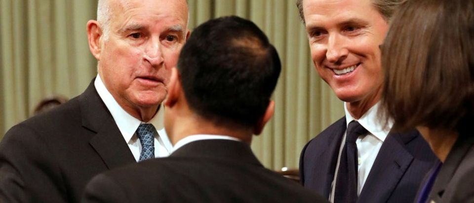 California Governor Jerry Brown and Lieutenant Governor Gavin Newsom greet well wishers after Brown delivered his final state of the state address in Sacramento