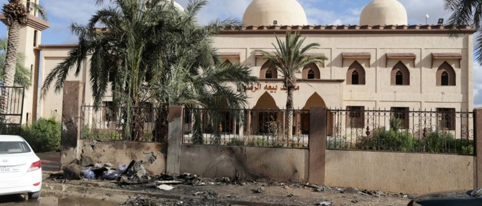 Damaged mosque walls are seen near the site of twin car bombs in Benghazi,