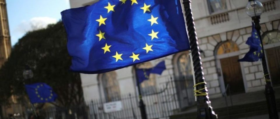 European Union flags fly from lamp posts opposite the Houses of Parliament in London