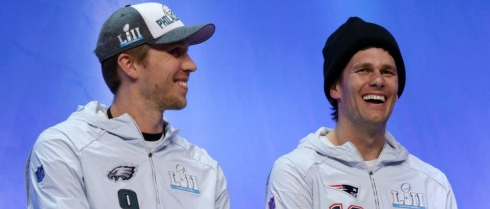 Tom Brady and Nick Foles share stage for interview during Super Bowl Opening Night in St Paul