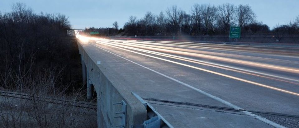 Traffic passes over a bridge for Interstate 270 that crosses Fee Fee Creek in Maryland Heights