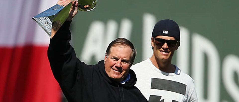 New England Patriots head coach Bill Belichick and quarterback Tom Brady walk toward the pitchers mound at Fenway Park before the game between the Boston Red Sox and the Washington Nationals on April 13, 2015 in Boston. (Photo by Maddie Meyer/Getty Images)