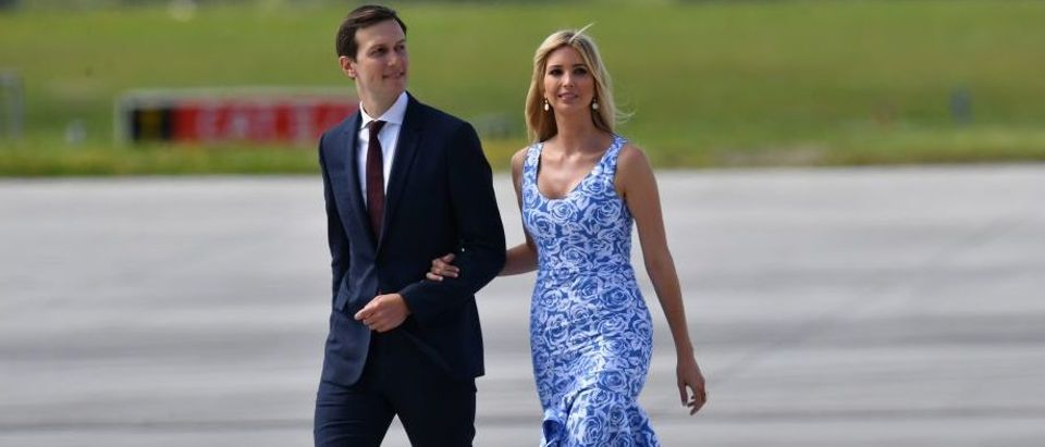 Ivanka Trump and Jared Kushner make their wave from Air Force One to Marina One upon arrival at the airport in Hamburg, northern Germany in July 2017. (Photo credit should read BERND VON JUTRCZENKA/AFP/Getty Images)