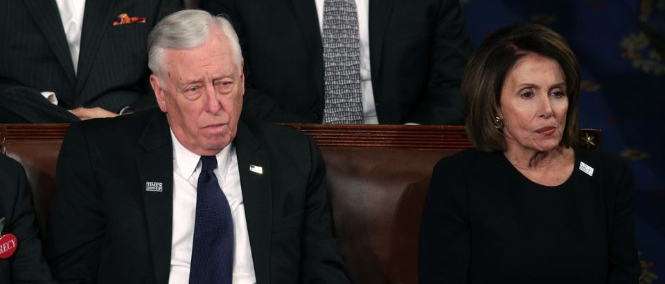 Nancy Pelosi and Steny Hoyer remain seated during the whole address. (Photo by Alex Wong/Getty Images)