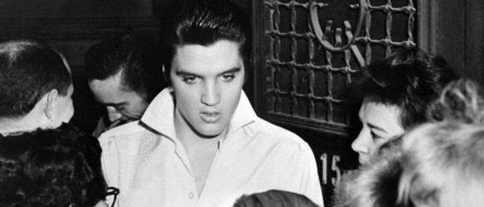 Elvis Presley is surrounded by fans after a concert in 1958. (Photo credit/AFP/Getty Images)