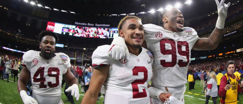 Jalen Hurts #2 of the Alabama Crimson Tide and Raekwon Davis #99 celebrate after the AllState Sugar Bowl against the Clemson Tigers at the Mercedes-Benz Superdome on January 1, 2018 in New Orleans, Louisiana. (Photo by Tom Pennington/Getty Images)