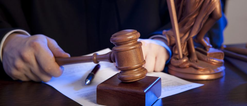 A judge strikes a gavel. (Photo: ShutterStock/Andrey Burmakin)