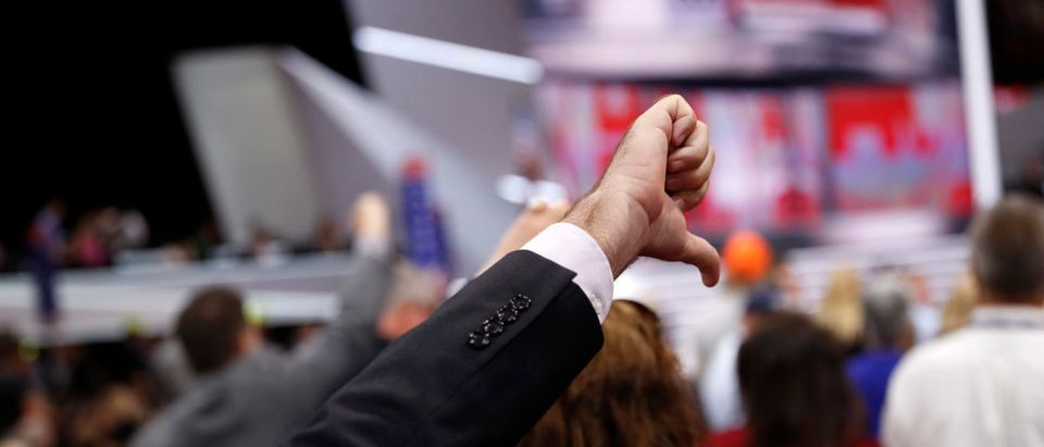 A Republican National Convention delegate gives a thumbs down at the Republican National Convention in Cleveland
