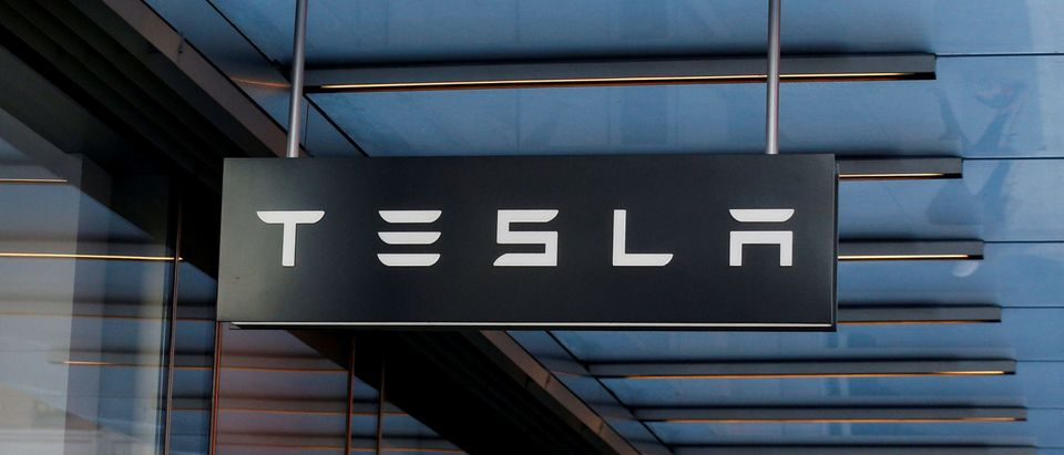 A sign is seen outside Tesla Motors' new showroom in Manhattan's Meatpacking District in New York City, U.S., December 14, 2017. REUTERS/Brendan McDermid | Teslas Credit Nosedives