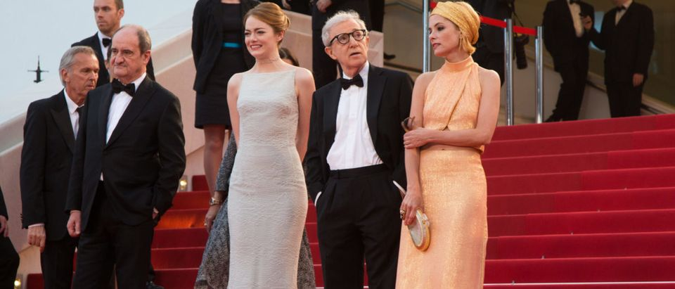 CANNES, FRANCE - MAY 15, 2015: Parker Posey, Woody Allen, Emma Stone attend the 'Irrational Man' premiere. 68th annual Cannes Film Festival at the Palais des Festivals Shutterstock/ magicinfoto