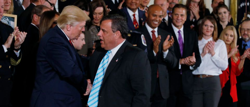 U.S. President Donald Trump greets New Jersey Governor Chris Christie (R) after speaking about administration plans to combat the nation's opioid crisis in the East Room of the White House in Washington, U.S., October 26, 2017 REUTERS/Carlos Barria
