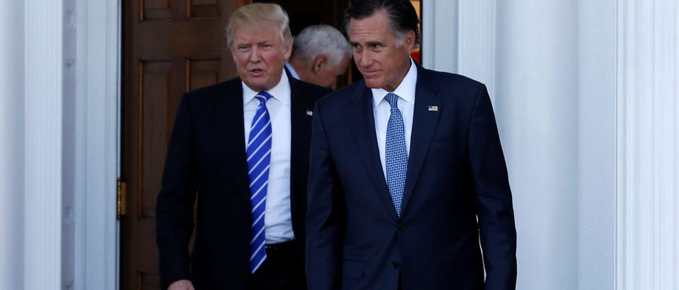 U.S. President-elect Donald Trump (L) and former Massachusetts Governor Mitt Romney emerge after their meeting at the main clubhouse at Trump National Golf Club in Bedminster, New Jersey, U.S., November 19, 2016. REUTERS/Mike Segar