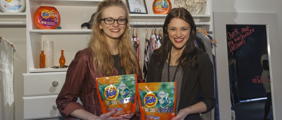 New York, NY - February 14, 2015: Sales girls display Tide Pods by Tide Procter & Gamble product during Fashion Week at Lincoln Center (Photo via Shutterstock)