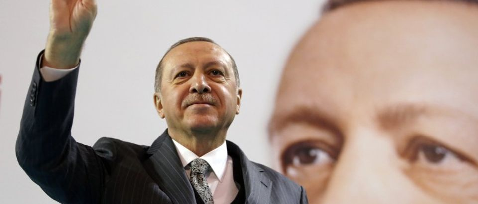 Turkish President Erdogan greets his supporters during a meeting of the ruling AK Party in Corum