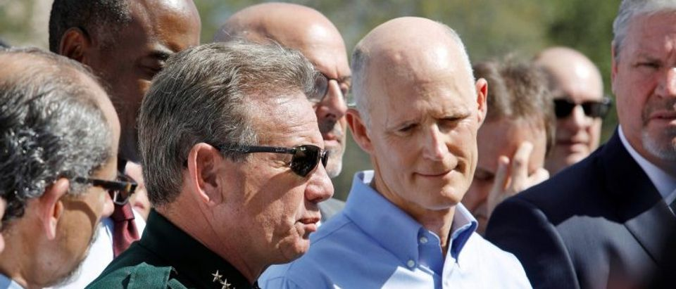 Broward County sheriff Israel and Florida Governor Scott outside Marjory Stoneman Douglas High School in Parkland