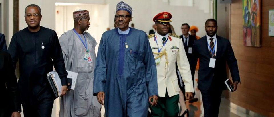 Nigerian's President Muhammadu Buhari arrives for the 30th Ordinary Session of the Assembly of the Heads of State and the Government of the African Union in Addis Ababa