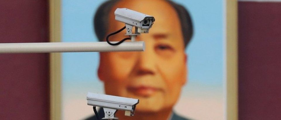 FILE PHOTO: Security cameras are seen in front of a portrait of late Chinese Chairman Mao at the Tiananmen gate in Beijing