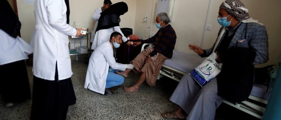 A volunteer doctor checks a patient at a charitable medical center which is offering free medical services to support those in need in Sanaa
