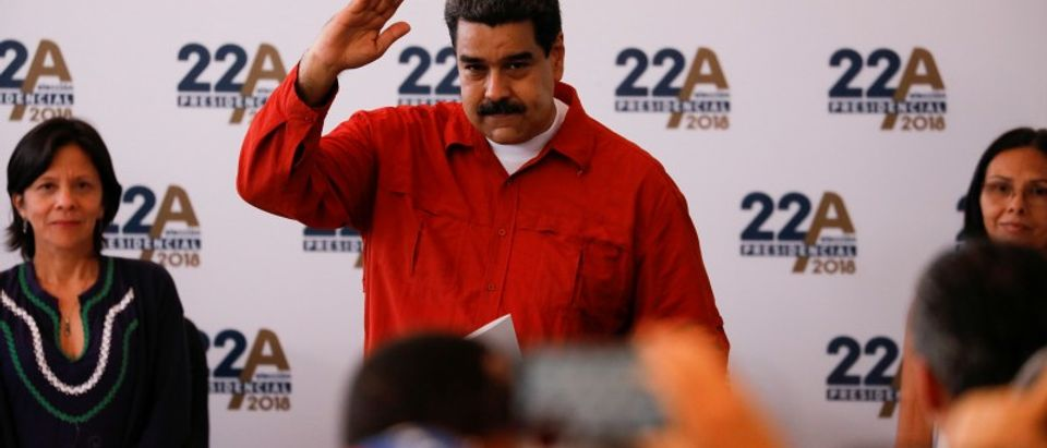 President Nicolas Maduro gestures as he registers his candidacy for re-election at the National Electoral Council (CNE) headquarters in Caracas