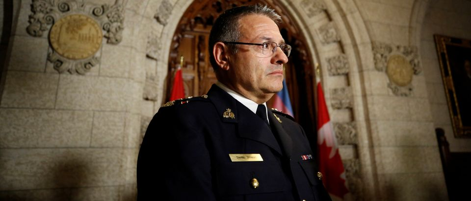Acting RCMP Commissioner Dubeau takes part in a news conference on Parliament Hill in Ottawa