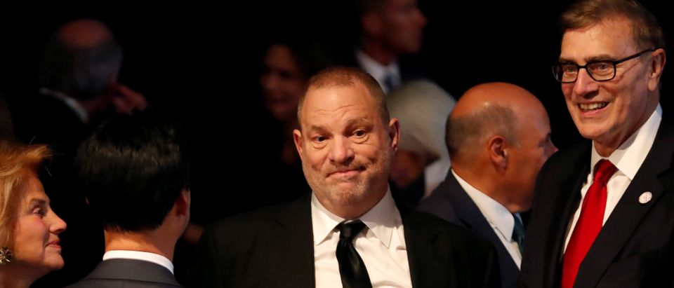 Producer Harvey Weinstein stands in the audience ahead of the first presidential debate between Donald trump and Hillary Clinton at Hofstra University in Hempstead, New York, September 26, 2016. REUTERS/Mike Segar