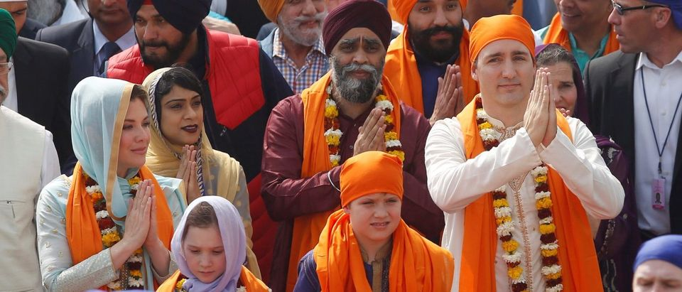Canadian Prime Minister Justin Trudeau, his wife Sophie Gregoire, daughter Ella Grace and son Xavier walk inside the premises of holy Sikh shrine of Golden temple in Amritsar