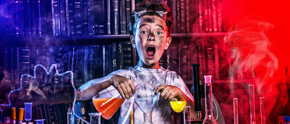 A boy doing experiments in the laboratory. Explosion in the laboratory. (Shutterstock/Kiselev Andrey Valerevich) | Liberals Fuming Over Atlantic's New Hire
