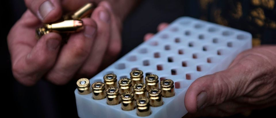 A member of the Georgia Security Force III% militia gathers 9mm ammunition before practicing shooting during a field training exercise July 28, 2017 in Jackson, Georgia. / AFP PHOTO / Brendan Smialowski (Photo credit should read BRENDAN SMIALOWSKI/AFP/Getty Images)