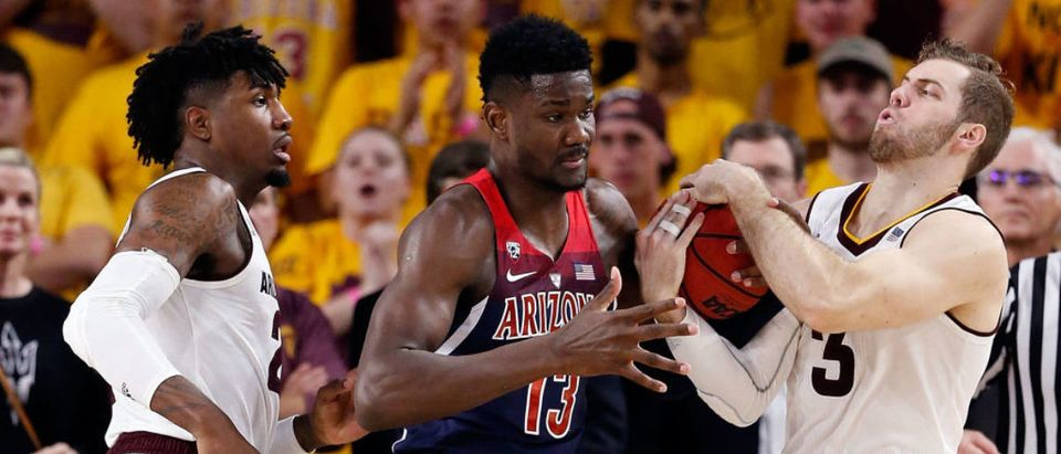 TEMPE, AZ - FEBRUARY 15: Romello White #23 and Mickey Mitchell #3 of the Arizona State Sun Devils steal the ball from Deandre Ayton #13 of the Arizona Wildcats during the second half of the college basketball game at Wells Fargo Arena on February 15, 2018 in Tempe, Arizona. The Wildcats beat the Sun Devils 77-70. (Photo by Chris Coduto/Getty Images)