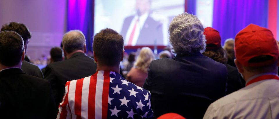 People listen as U.S. President Donald Trump speaks at the Conservative Political Action Conference (CPAC) at National Harbor, Maryland, U.S., February 23, 2018. REUTERS/Joshua Roberts