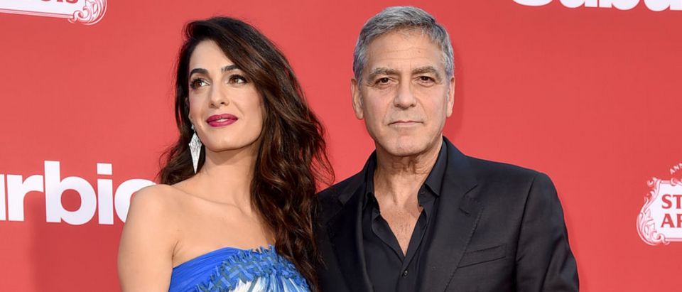 Executive producer George Clooney (R) and his wife Amal Clooney arrive at the premiere of Paramount Pictures' 'Suburbicon' at the Village Theatre on October 22, 2017 in Los Angeles, California. (Photo by Kevin Winter/Getty Images)